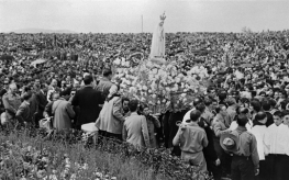 "A statue of the Holy Mary of Fatima is carried during a procession at the Catholic Fatima shrine in central Portugal, in May 1951. Thousands of pilgrims converged on Fatima every year to celebrate the ""first apparition"" of the Virgin Mary in 1917. The Virgin Mary, or the ""Virgin of the Rosary"", Our Lady of Fatima, was said to have appeared to three Portuguese shepherd children Lucia Dos Santos, Jacinta and Francisco Marto in 1917 and given them three messages - one about the end of WW I, one other about Russia and a third ""secret"" that the Vatican never revealed."